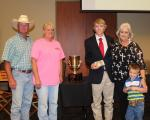 2015<br><br>Jarrett Mackie<br><br>Leonard and Darlene Graham donated the trophy.<br><br>Linda Hicks and grandson Wylie are in photo.<br><br>John Price will add Jarrett's name to the traveling trophy.<br><br><a href='page.php?id=107'>Memorial to Pevine Hicks</a>